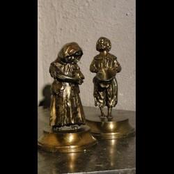 Couple de mendiants en régule doré